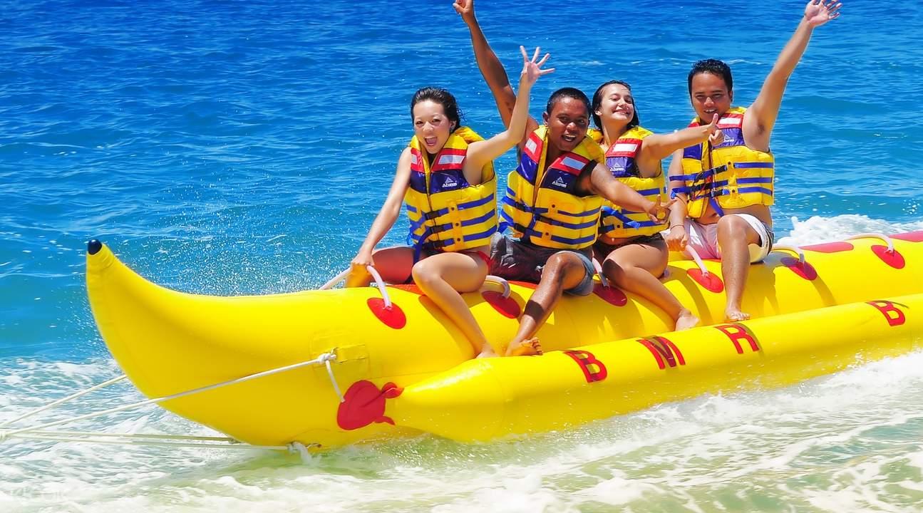people riding a banana boat at tenjung benoa